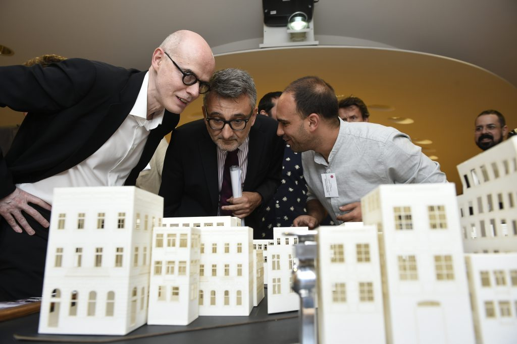 Vladimir Šucha and Xavier Troussard visiting the exhibition and interacting with Gossip Chain presented by Enrique Encinas