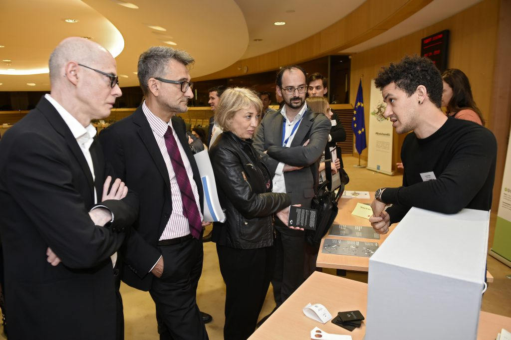 Vladimir Šucha, Xavier Troussard and Fabiana Scapolo visiting the exhibition and interacting with Care AI presented by Lucas Peña.
